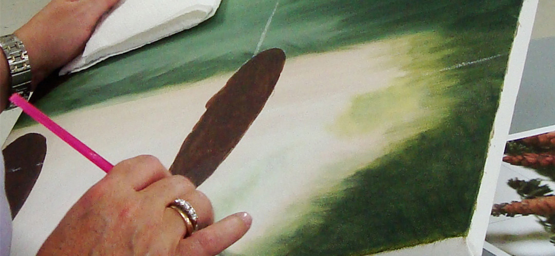 A student practicing her painting skills in one of Ginok's classes.